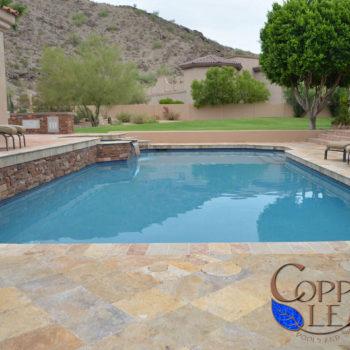 Diamond set travertine paver installation and pool coping.