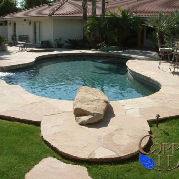 Lagoon Pool - Free form pool with diving rock and flagstone decking.