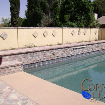 Spanish Style Pool - Burnt adobe brick on raised wall with sheer descent water feature
