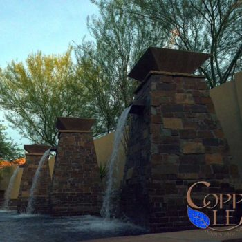 Copper scuppers on columns with fire pots in north Phoenix