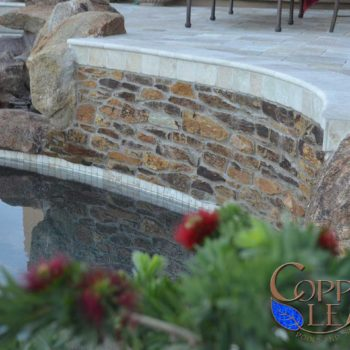 Arizona schist stone on raised pool wall.