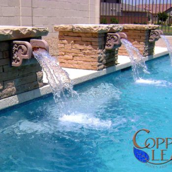 Stone columns with custom cantera scuppers and flagstone cap.