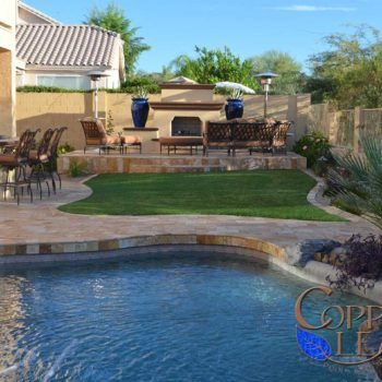 Free form pool remodel with gold travertine pavers.