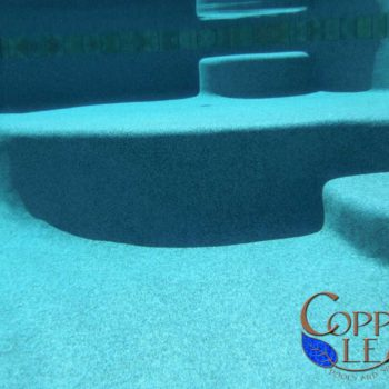 Over sized underwater step with blue granite Pebble Sheen
