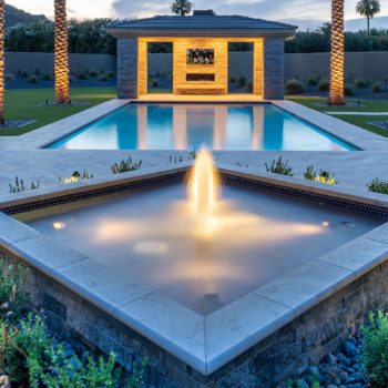 The rectangle pool has a ramada with fireplace and stand alone fountain