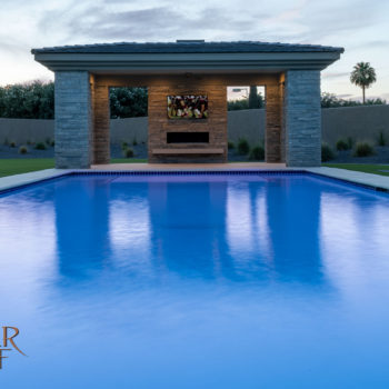The plaster pool with travertine coping views Camelback Mountain