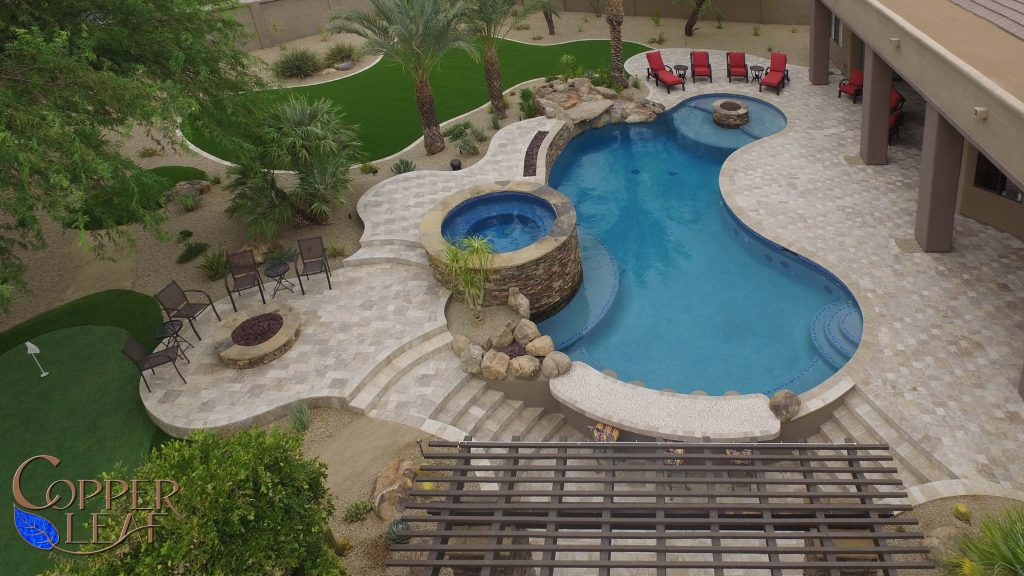 Custom swimming pool, spa, fire pits and many other landscape features.