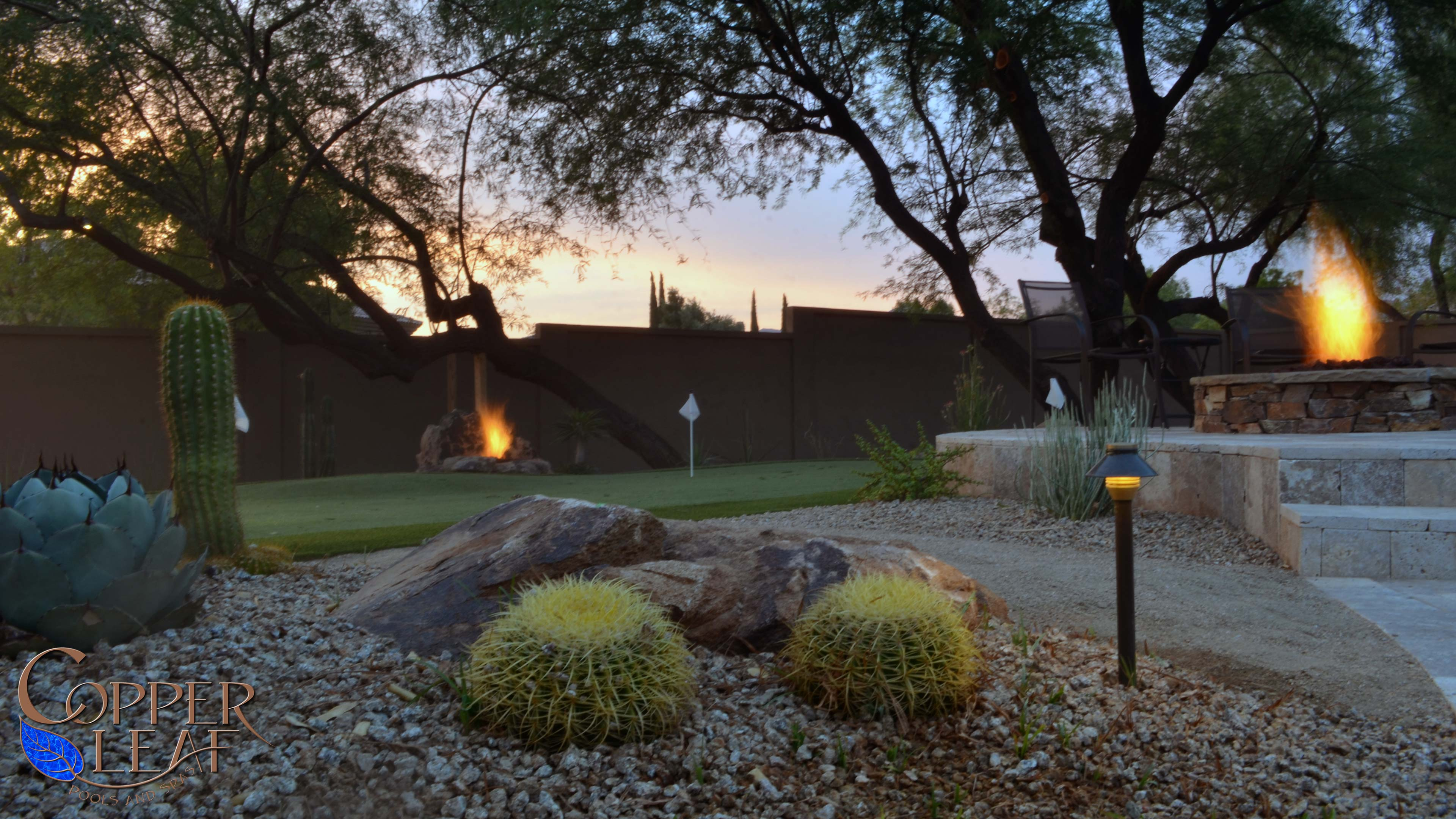 Sunset looking over a putting green made with artificial turf.