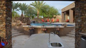 Swimming pool with swim up bar.