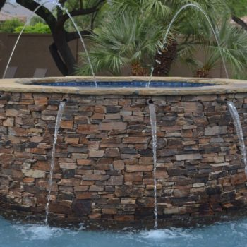 Raised spa with copper scuppers and laminar water features.