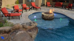 Fire pit on step of swimming pool.