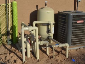 Swimming Pool Equipment - Swimming pool filter and dual pumps, one for general cleaning and one for a water feature.