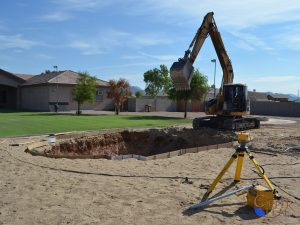 Pool Excavation - Excavation of swimming pool using laser level to precisely determine depth.