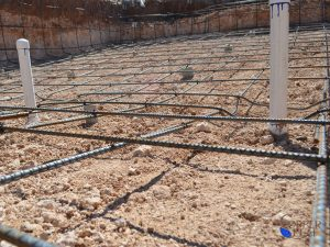 Steel Rebar - Close up of the steel rebar that supports and reinforces the shell of the swimming pool.